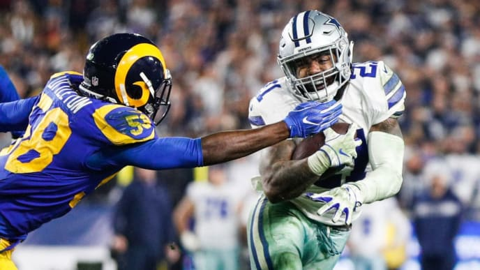 LOS ANGELES, CA - JANUARY 12: Inside linebacker Cory Littleton #58 of the Los Angeles Rams stops running back Ezekiel Elliott #21 of the Dallas Cowboys in the fourth quarter of the NFC Divisional Round playoff game at Los Angeles Memorial Coliseum on January 12, 2019 in Los Angeles, California. (Photo by Meg Oliphant/Getty Images)