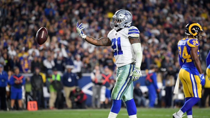 LOS ANGELES, CA - JANUARY 12:  Ezekiel Elliott #21 of the Dallas Cowboys celebrates after scoring a 1 yard touchdown in the third quarter against the Los Angeles Rams in the NFC Divisional Playoff game at Los Angeles Memorial Coliseum on January 12, 2019 in Los Angeles, California.  (Photo by Harry How/Getty Images)
