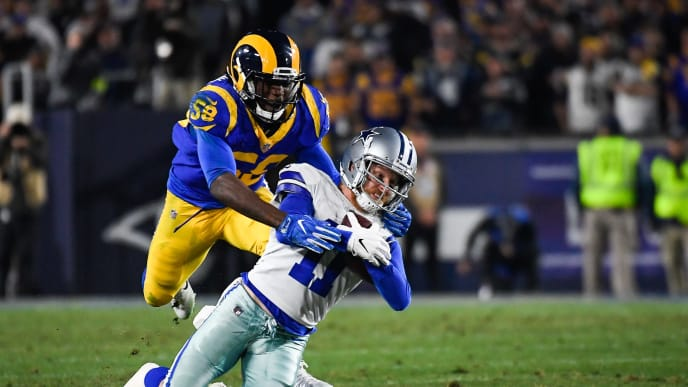 LOS ANGELES, CA - JANUARY 12: Wide receiver Cole Beasley #11 of the Dallas Cowboys makes a catch for a first down in the fourth quarter in front of linebacker Micah Kiser #59 of the Los Angeles Rams in the NFC Divisional Round playoff game at Los Angeles Memorial Coliseum on January 12, 2019 in Los Angeles, California. (Photo by Kevork Djansezian/Getty Images)