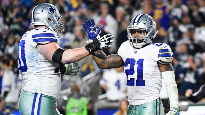 LOS ANGELES, CA - JANUARY 12: Running back Ezekiel Elliott #21 of the Dallas Cowboys celebrates his touchdown with offensive guard Zack Martin #70 in the third quarter against the Los Angeles Rams in the NFC Divisional Round playoff game at Los Angeles Memorial Coliseum on January 12, 2019 in Los Angeles, California. (Photo by Kevork Djansezian/Getty Images)