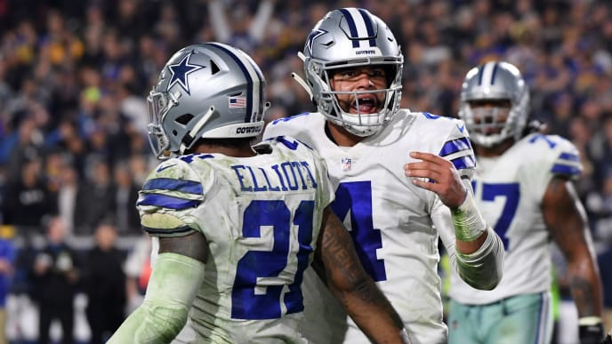 LOS ANGELES, CA - JANUARY 12:  Dak Prescott #4 and Ezekiel Elliott #21 of the Dallas Cowboys react after a Prescott touchdown late in the fourth quarter against the Los Angeles Rams in the NFC Divisional Playoff game at Los Angeles Memorial Coliseum on January 12, 2019 in Los Angeles, California.  (Photo by Harry How/Getty Images)