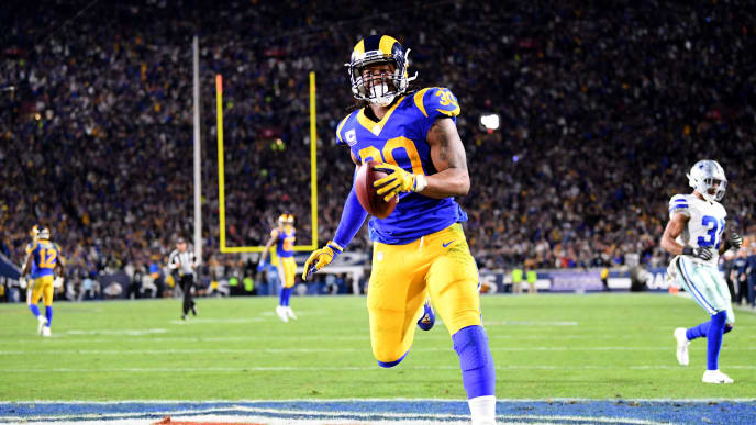 LOS ANGELES, CA - JANUARY 12:  Todd Gurley #30 of the Los Angeles Rams scores a 35 yard touchdown in the second quarter against the Dallas Cowboys in the NFC Divisional Playoff game at Los Angeles Memorial Coliseum on January 12, 2019 in Los Angeles, California.  (Photo by Harry How/Getty Images)