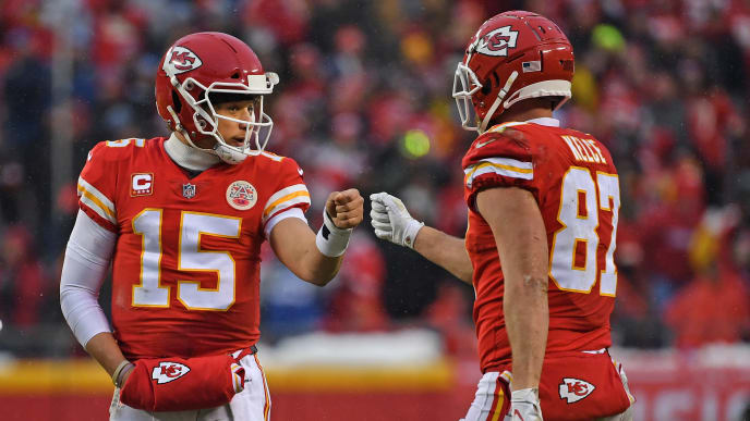 KANSAS CITY, MO - JANUARY 12: Quarterback Patrick Mahomes #15 of the Kansas City Chiefs givs tight end Travis Kelce #87 a fist pump after a play against the Indianapolis Colts, during the first half of the AFC Divisional Round playoff game at Arrowhead Stadium on January 12, 2019 in Kansas City, Missouri. (Photo by Peter G. Aiken/Getty Images)