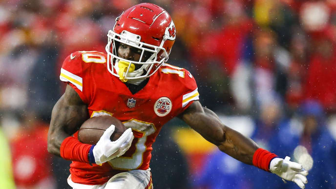 KANSAS CITY, MO - JANUARY 12: Wide receiver Tyreek Hill #10 of the Kansas City Chiefs runs after a pass catch against the Indianapolis Colts in the AFC Divisional Playoff at Arrowhead Stadium on January 12, 2019 in Kansas City, Missouri. (Photo by David Eulitt/Getty Images)