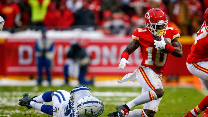 KANSAS CITY, MO - JANUARY 12: Tyreek Hill #10 of the Kansas City Chiefs tries to avoid the diving tackle attempt of Al-Quadin Muhammad #97 of the Indianapolis Colts during the first quarter of the AFC Divisional Round playoff game at Arrowhead Stadium on January 12, 2019 in Kansas City, Missouri. (Photo by David Euilitt/Getty Images)