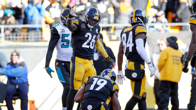 PITTSBURGH, PA - JANUARY 14:  Le'Veon Bell #26 of the Pittsburgh Steelers celebrates with teammates after a touchdown against the Jacksonville Jaguars during the second half of the AFC Divisional Playoff game at Heinz Field on January 14, 2018 in Pittsburgh, Pennsylvania.  (Photo by Kevin C. Cox/Getty Images)