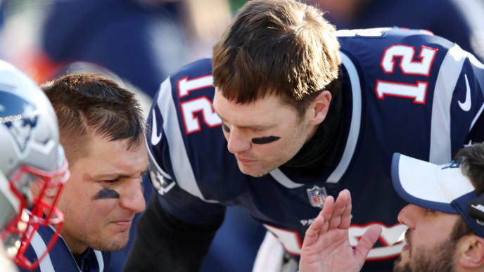 FOXBOROUGH, MASSACHUSETTS - JANUARY 13: Tom Brady #12 of the New England Patriots and Rob Gronkowski #87 talk during the second quarter in the AFC Divisional Playoff Game against the Los Angeles Chargers at Gillette Stadium on January 13, 2019 in Foxborough, Massachusetts. (Photo by Adam Glanzman/Getty Images)