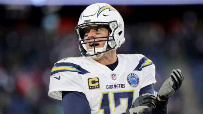 FOXBOROUGH, MASSACHUSETTS - JANUARY 13: Philip Rivers #17 of the Los Angeles Chargers reacts during the fourth quarter in the AFC Divisional Playoff Game against the New England Patriots at Gillette Stadium on January 13, 2019 in Foxborough, Massachusetts. (Photo by Elsa/Getty Images)