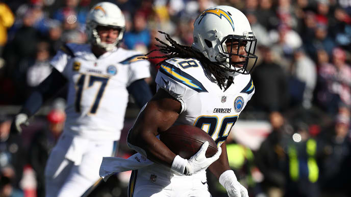 FOXBOROUGH, MASSACHUSETTS - JANUARY 13:  Melvin Gordon #28 of the Los Angeles Chargers in action against the New England Patriots during their AFC Divisional Round playoff game at Gillette Stadium on January 13, 2019 in Foxborough, Massachusetts. (Photo by Al Bello/Getty Images)