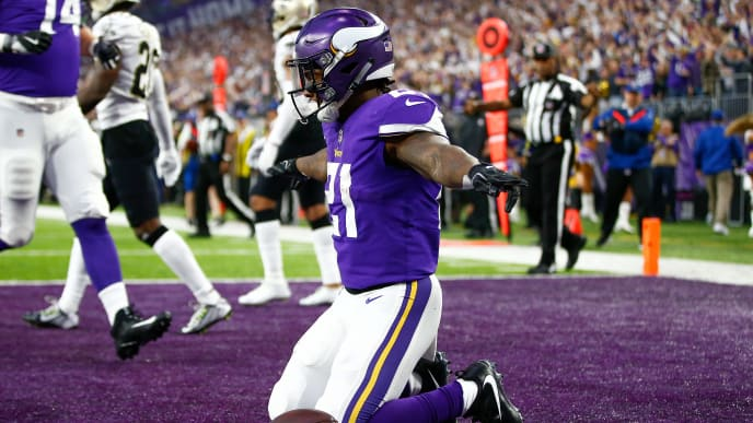 MINNEAPOLIS, MN - JANUARY 14:  Jerick McKinnon #21 of the Minnesota Vikings celebrates after scoring a touchdown against the New Orleans Saints during the first half of the NFC Divisional Playoff game at U.S. Bank Stadium on January 14, 2018 in Minneapolis, Minnesota.  (Photo by Jamie Squire/Getty Images)