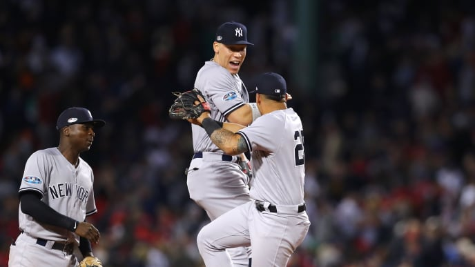 BOSTON, MA - OCTOBER 06:  Aaron Judge #99 (C) and Gleyber Torres #25 of the New York Yankees celebrate as teammate  Didi Gregorius #18  looks on after their 6-2 win in Game Two of the American League Division Series against the Boston Red Sox at Fenway Park on October 6, 2018 in Boston, Massachusetts. The Yankees defeated the Red Boston Red Sox 6-2.  (Photo by Tim Bradbury/Getty Images)