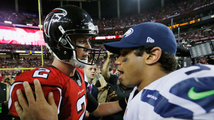 ATLANTA, GA - JANUARY 14:   Matt Ryan #2 of the Atlanta Falcons and  Russell Wilson #3 of the Seattle Seahawks meet on the field after the Atlanta Falcons win at the Georgia Dome on January 14, 2017 in Atlanta, Georgia.  (Photo by Kevin C. Cox/Getty Images)