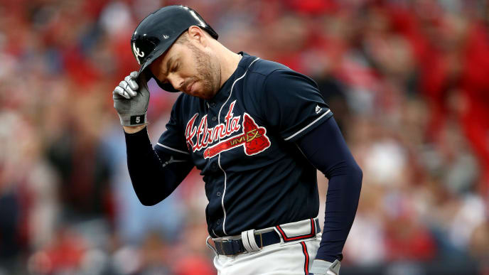 ST LOUIS, MISSOURI - OCTOBER 06:  Freddie Freeman #5 of the Atlanta Braves strikes out against the St. Louis Cardinals during the sixth inning in game three of the National League Division Series at Busch Stadium on October 06, 2019 in St Louis, Missouri. (Photo by Jamie Squire/Getty Images)