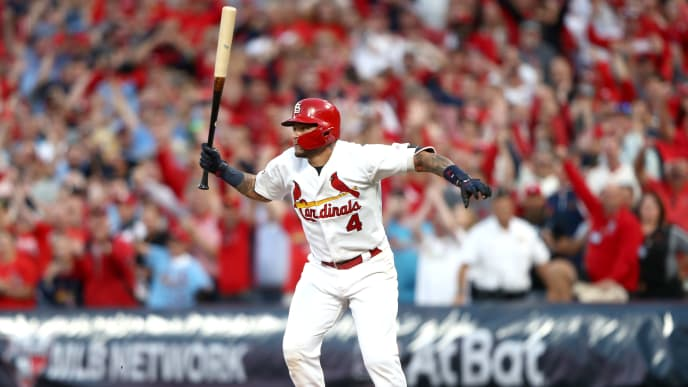 ST LOUIS, MISSOURI - OCTOBER 07:  Yadier Molina #4 of the St. Louis Cardinals hits a walk-off sacrifice fly to give his team the 5-4 win over the Atlanta Braves in game four of the National League Division Series at Busch Stadium on October 07, 2019 in St Louis, Missouri. (Photo by Jamie Squire/Getty Images)