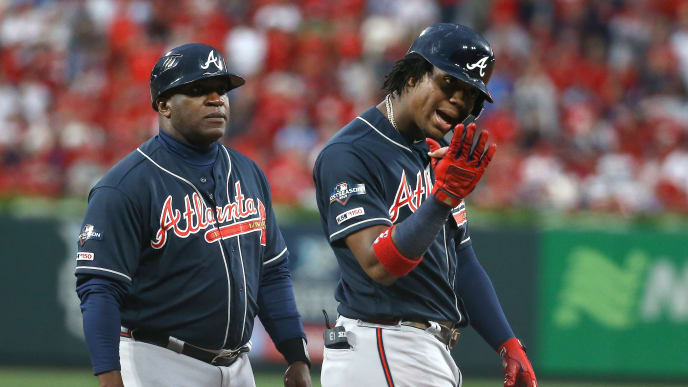 ST LOUIS, MISSOURI - OCTOBER 06:  Ronald Acuna Jr. #13 of the Atlanta Braves reacts after he gets brushed back on ball four on a pitch from Carlos Martinez (not pictured) of the St. Louis Cardinals during the ninth inning in game three of the National League Division Series at Busch Stadium on October 06, 2019 in St Louis, Missouri. (Photo by Scott Kane/Getty Images)