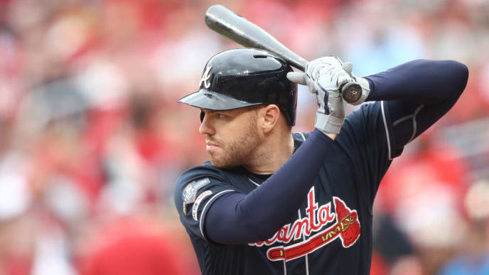 ST LOUIS, MISSOURI - OCTOBER 06:   Freddie Freeman #5 of the Atlanta Braves awaits the pitch against the St. Louis Cardinals during the first inning in game three of the National League Division Series at Busch Stadium on October 06, 2019 in St Louis, Missouri. (Photo by Jamie Squire/Getty Images)