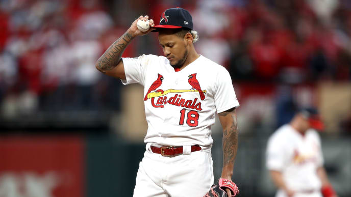 ST LOUIS, MISSOURI - OCTOBER 06:  Carlos Martinez #18 of the St. Louis Cardinals reacts after allowing a double to Josh Donaldson (not pictured) of the Atlanta Braves during the ninth inning in game three of the National League Division Series at Busch Stadium on October 06, 2019 in St Louis, Missouri. (Photo by Jamie Squire/Getty Images)