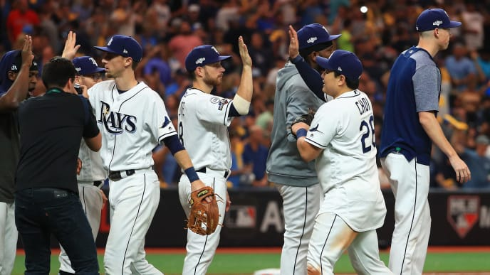 ST PETERSBURG, FLORIDA - OCTOBER 08:  The Tampa Bay Rays celebrate their 4-1 win over the Houston Astros in game four of the American League Division Series at Tropicana Field on October 08, 2019 in St Petersburg, Florida. (Photo by Mike Ehrmann/Getty Images)