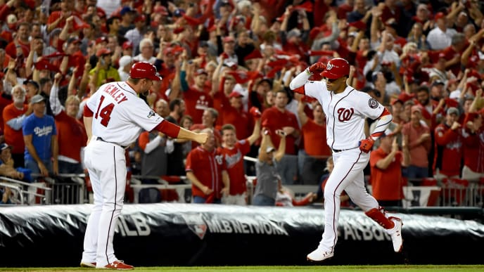WASHINGTON, DC - OCTOBER 06: Juan Soto #22 of the Washington Nationals celebrates with third base coach Bob Henley #14 after hitting a two-run home run against the Los Angeles Dodgers in game three of the National League Division Series at Nationals Park on October 6, 2019 in Washington, DC. (Photo by Will Newton/Getty Images)