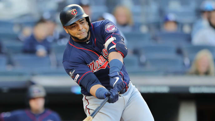 NEW YORK, NEW YORK - OCTOBER 05: Nelson Cruz #23 of the Minnesota Twins hits a single off Masahiro Tanaka #19 of the New York Yankees in the first inning of game two of the American League Division Series at Yankee Stadium on October 05, 2019 in New York City. (Photo by Elsa/Getty Images)