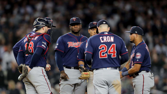 NEW YORK, NEW YORK - OCTOBER 04: The Minnesota Twins talk on the mound against the New York Yankees during the fifth inning in game one of the American League Division Series at Yankee Stadium on October 04, 2019 in New York City. (Photo by Elsa/Getty Images)