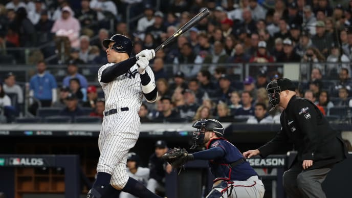 NEW YORK, NEW YORK - OCTOBER 05: Aaron Judge #99 of the New York Yankees hits a single in the third inning of game two of the American League Division Series against the Minnesota Twins at Yankee Stadium on October 05, 2019 in New York City. (Photo by Al Bello/Getty Images)