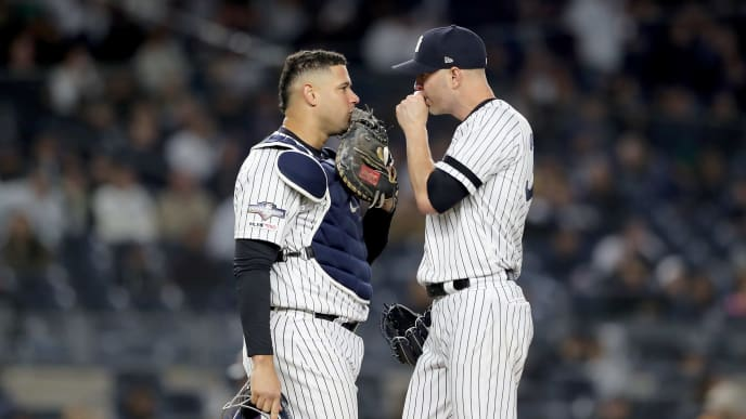 NEW YORK, NEW YORK - OCTOBER 04: J.A. Happ #34 of the New York Yankees talks with Gary Sanchez #24 against the Minnesota Twins during the seventh inning in game one of the American League Division Series at Yankee Stadium on October 04, 2019 in New York City. (Photo by Elsa/Getty Images)
