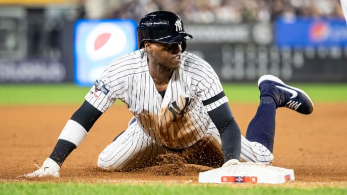 NEW YORK, NY - OCTOBER 04: Cameron Maybin #38 of the New York Yankees slides against the Minnesota Twins on October 4, 2019 in game one of the American League Division Series at Yankee Stadium in the Bronx borough of New York City. (Photo by Brace Hemmelgarn/Minnesota Twins/Getty Images)