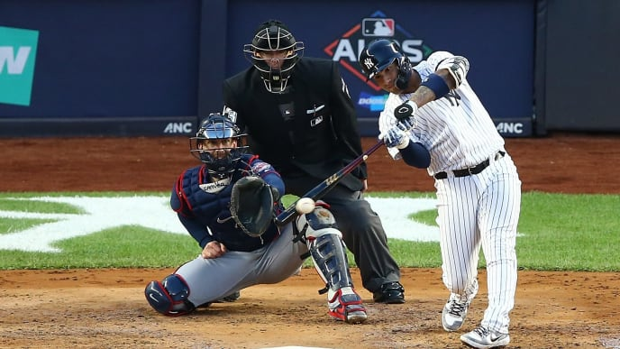 NEW YORK, NEW YORK - OCTOBER 05: Gleyber Torres #25 of the New York Yankees hits a RBI single in the third inning against the Minnesota Twins during game two of the American League Division Series at Yankee Stadium on October 05, 2019 in New York City. (Photo by Mike Stobe/Getty Images)
