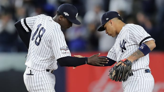 NEW YORK, NEW YORK - OCTOBER 05: Didi Gregorius #18 and Gleyber Torres #25 of the New York Yankees celebrate their 8-2 win over the Minnesota Twins in game two of the American League Division Series at Yankee Stadium on October 05, 2019 in New York City. (Photo by Elsa/Getty Images)