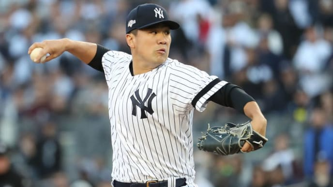 NEW YORK, NEW YORK - OCTOBER 05: Masahiro Tanaka #19 of the New York Yankees throws a pitch in the first inning of game two of the American League Division Series against the Minnesota Twins at Yankee Stadium on October 05, 2019 in New York City. (Photo by Al Bello/Getty Images)
