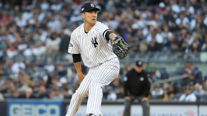 NEW YORK, NEW YORK - OCTOBER 05: Masahiro Tanaka #19 of the New York Yankees throws a pitch in the second inning of game two of the American League Division Series against the Minnesota Twins at Yankee Stadium on October 05, 2019 in New York City. (Photo by Al Bello/Getty Images)