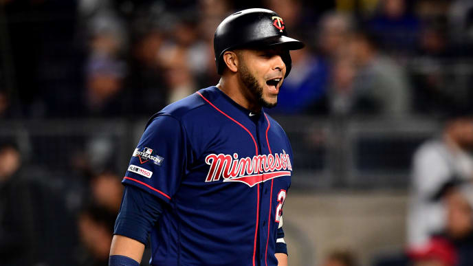 NEW YORK, NEW YORK - OCTOBER 04: Nelson Cruz #23 of the Minnesota Twins celebrates after hitting a solo home run against James Paxton #65 of the New York Yankees during the third inning in game one of the American League Division Series at Yankee Stadium on October 04, 2019 in New York City. (Photo by Emilee Chinn/Getty Images)