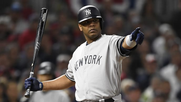 MINNEAPOLIS, MINNESOTA - OCTOBER 07: Edwin Encarnacion #30 of the New York Yankees reacts to a check swing in game three of the American League Division Series against the Minnesota Twins at Target Field on October 07, 2019 in Minneapolis, Minnesota. (Photo by Hannah Foslien/Getty Images)