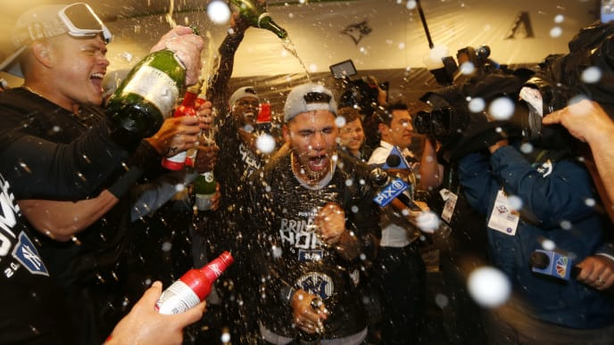 MINNEAPOLIS, MINNESOTA - OCTOBER 07: Gleyber Torres #25 of the New York Yankees celebrates with teammates in the locker room after sweeping the Minnesota Twins 3-0 in the American League Division Series to advance to the American League Championship Series at Target Field on October 07, 2019 in Minneapolis, Minnesota. (Photo by Elsa/Getty Images)