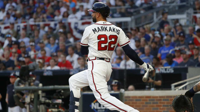 ATLANTA, GEORGIA - OCTOBER 03:  Nick Markakis #22 of the Atlanta Braves hits a double against the St. Louis Cardinals during the sixth inning in game one of the National League Division Series at SunTrust Park on October 03, 2019 in Atlanta, Georgia. (Photo by Kevin C. Cox/Getty Images)