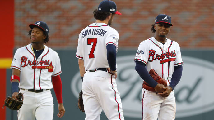 ATLANTA, GEORGIA - OCTOBER 09:  Ozzie Albies #1 of the Atlanta Braves reacts after committing a fielding error against the St. Louis Cardinals during the third inning in game five of the National League Division Series at SunTrust Park on October 09, 2019 in Atlanta, Georgia. (Photo by Kevin C. Cox/Getty Images)