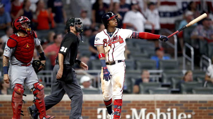 ATLANTA, GEORGIA - OCTOBER 03:  Ronald Acuna Jr. #13 of the Atlanta Braves hits a two-run home run against the St. Louis Cardinals during the ninth inning in game one of the National League Division Series at SunTrust Park on October 03, 2019 in Atlanta, Georgia. (Photo by Todd Kirkland/Getty Images)