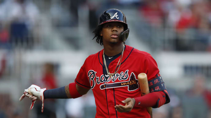ATLANTA, GEORGIA - OCTOBER 04: Ronald Acuna Jr. #13 of the Atlanta Braves reacts after striking out to Jack Flaherty #22 of the St. Louis Cardinals in the fifth inning in game two of the National League Division Series at SunTrust Park on October 04, 2019 in Atlanta, Georgia. (Photo by Todd Kirkland/Getty Images)