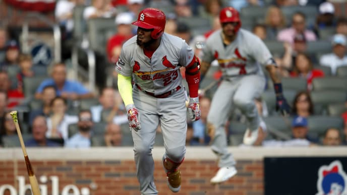 ATLANTA, GEORGIA - OCTOBER 09:  Marcell Ozuna #23 of the St. Louis Cardinals advances to first base safely on a strikeout and a wild pitch against the Atlanta Braves during the first inning in game five of the National League Division Series at SunTrust Park on October 09, 2019 in Atlanta, Georgia. (Photo by Todd Kirkland/Getty Images)