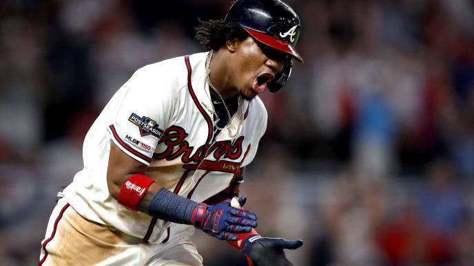 ATLANTA, GEORGIA - OCTOBER 03:  Ronald Acuna Jr. #13 of the Atlanta Braves celebrates after he hits a two-run home run against the St. Louis Cardinals during the ninth inning in game one of the National League Division Series at SunTrust Park on October 03, 2019 in Atlanta, Georgia. (Photo by Todd Kirkland/Getty Images)