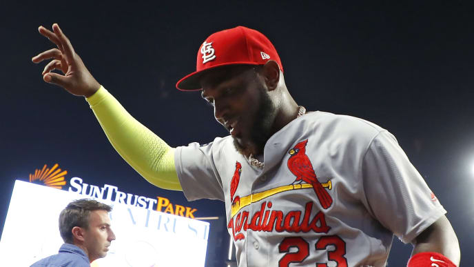 ATLANTA, GEORGIA - OCTOBER 03:  Marcell Ozuna #23 of the St. Louis Cardinals walks off the field after his teams 7-6 win over the Atlanta Braves in game one of the National League Division Series at SunTrust Park on October 03, 2019 in Atlanta, Georgia. (Photo by Kevin C. Cox/Getty Images)