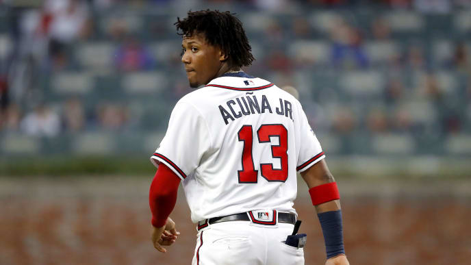 ATLANTA, GEORGIA - OCTOBER 09:  Ronald Acuna Jr. #13 of the Atlanta Braves reacts after the side is retired in the fifth inning against the St. Louis Cardinals in game five of the National League Division Series at SunTrust Park on October 09, 2019 in Atlanta, Georgia. (Photo by Kevin C. Cox/Getty Images)