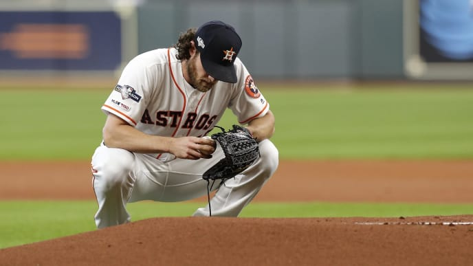 HOUSTON, TX - OCTOBER 10:  Gerrit Cole #45 of the Houston Astros pauses before taking the mound in the first inning against the Tampa Bay Rays at Minute Maid Park on October 10, 2019 in Houston, Texas.  (Photo by Tim Warner/Getty Images)