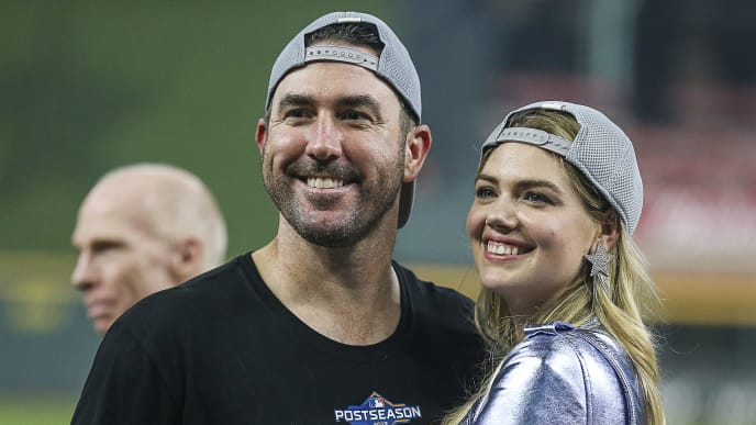 HOUSTON, TEXAS - OCTOBER 10: Justin Verlander #35 of the Houston Astros and his wife model Kate Upton celebrate after winning Game 5 of the ALDS  at Minute Maid Park on October 10, 2019 in Houston, Texas. Houston advances with a 6-1 win. (Photo by Bob Levey/Getty Images)