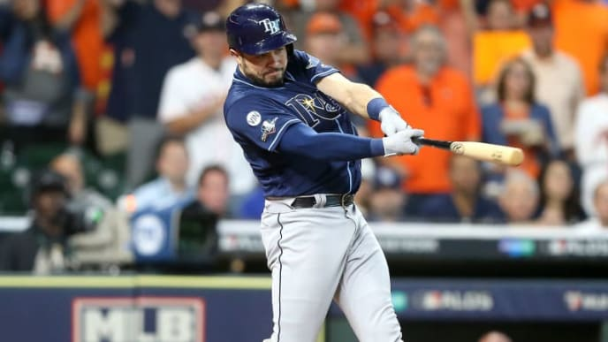 HOUSTON, TEXAS - OCTOBER 10:  Travis d'Arnaud #37 of the Tampa Bay Rays flies out against the Houston Astros during the first inning in game five of the American League Division Series at Minute Maid Park on October 10, 2019 in Houston, Texas. (Photo by Bob Levey/Getty Images)