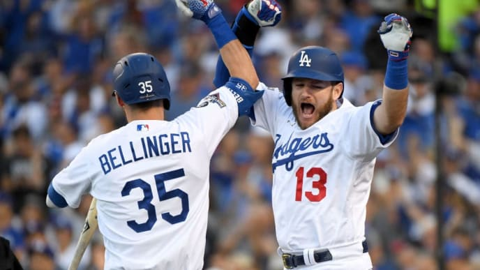 LOS ANGELES, CALIFORNIA - OCTOBER 09: Max Muncy #13 of the Los Angeles Dodgers celebrates his two run home run with teammate Cody Bellinger #35 during the first inning of game five of the National League Division Series against the Washington Nationals at Dodger Stadium on October 09, 2019 in Los Angeles, California. (Photo by Harry How/Getty Images)
