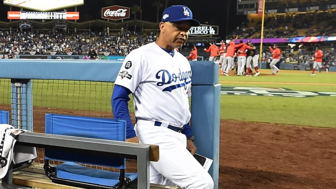LOS ANGELES, CALIFORNIA - OCTOBER 09: Manager Dave Roberts of the Los Angeles Dodgers leaves the dug out as the Washington Nationals celebrate their 7-3 game five win to clinch the National League Division Series at Dodger Stadium on October 09, 2019 in Los Angeles, California. (Photo by Harry How/Getty Images)
