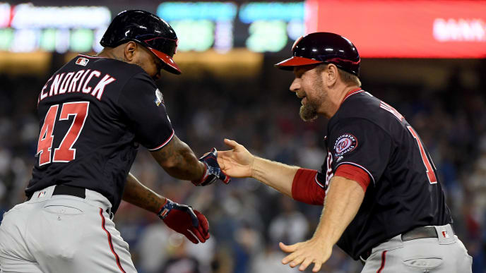 LOS ANGELES, CALIFORNIA - OCTOBER 09: Howie Kendrick #47 of the Washington Nationals celebrates celebrates his grand slam homerun with third base coach Bob Henley #14 against the Los Angeles Dodgers in the tenth inning of game five of the National League Division Series at Dodger Stadium on October 09, 2019 in Los Angeles, California. (Photo by Harry How/Getty Images)