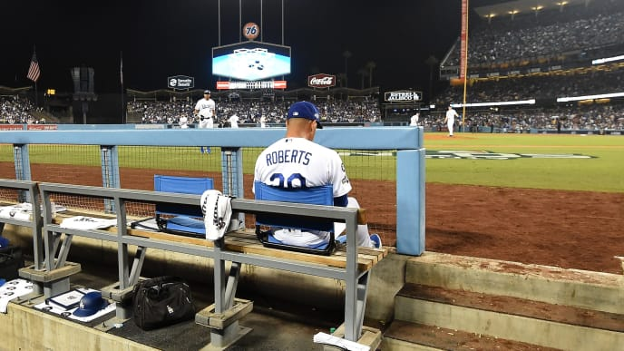 LOS ANGELES, CALIFORNIA - OCTOBER 09: Manager Dave Roberts of the Los Angeles Dodgers sits in the dug out during game five of the National League Division Series against the Washington Nationals at Dodger Stadium on October 09, 2019 in Los Angeles, California. The Nationals defeated the Dodgers 7-3 and clinch the series 3-2. (Photo by Harry How/Getty Images)